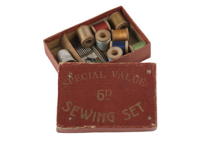 Sewing set stored in red card box; 1908