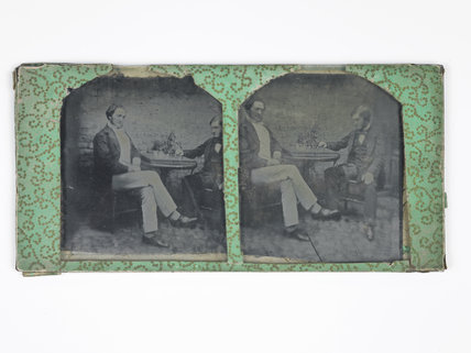 Two Victorian men sat at a table; c.1860