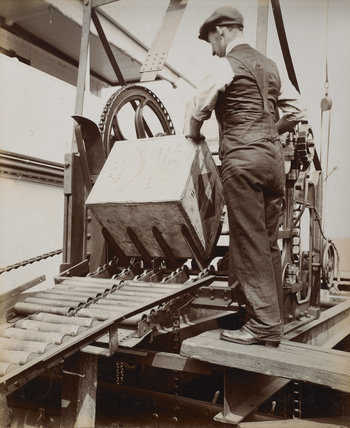 Discharging tea by mechanical conveyor:c.1920