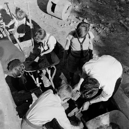 Playing with sand at the Clydesdale adventure Playground: 1954