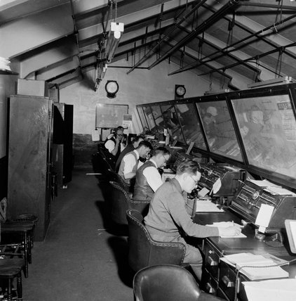 Employees at work in the offices at Reigate station; 1957