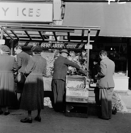 nspector of Weights and Measures at a vegetable stall; 1956