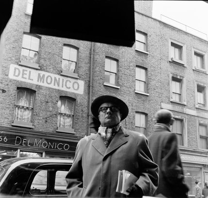 Man outside Del Monico wine shop; 1955