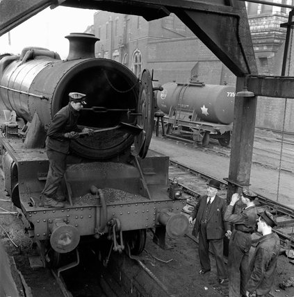 Trainee engine drivers emptying the smokebox char; 1955