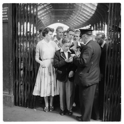 Railway station ticket inspector; c.1960