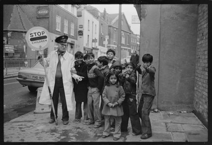 'Lollipop man' with school children: 1979