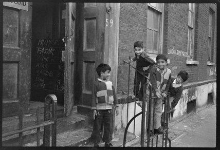 Children at the door of the Brick Lane Jamme Masjid Mosque: 1976