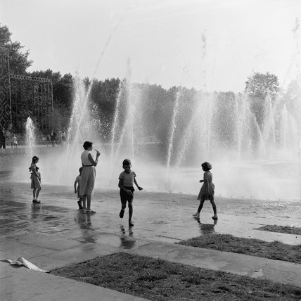 Children playing in the water fountains in the Festival Gardens; c.1955