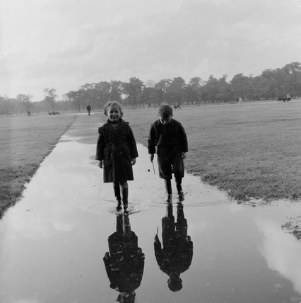 Children walking on a pathway  Kensington Gardens; 1958