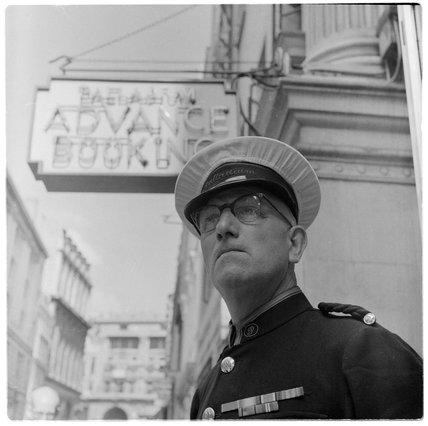 Doorman outside the London Palladium theatre; 1956