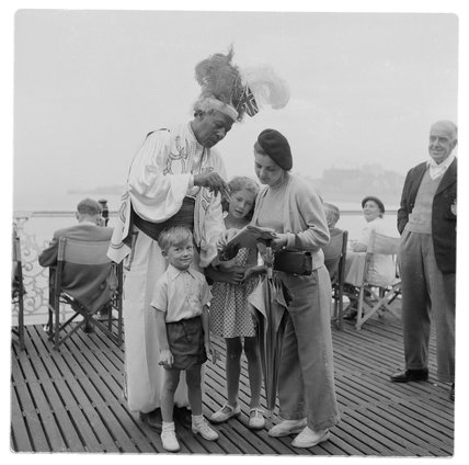Ras Prince Monolulu attending the races in Brighton; c 1955