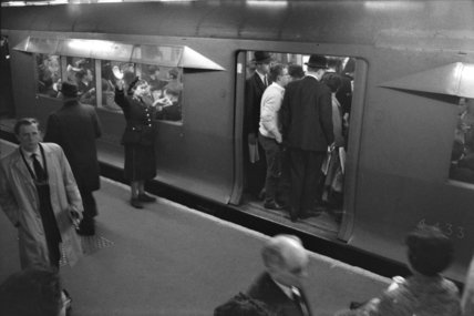 Boarding the tube at rush hour; c.1960