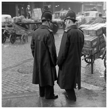 Two policeman outside Billingsgate Market; 1958