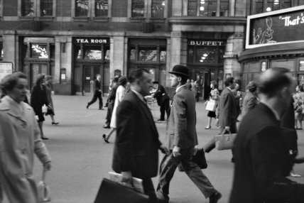 A City gent outside Waterloo Station; c.1960