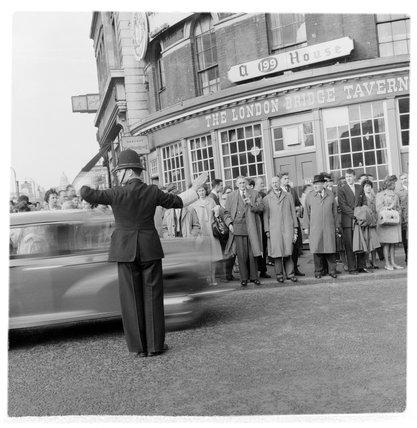 A policeman directing traffic at London Bridge; c1960