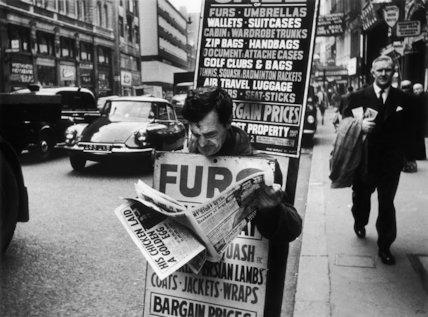 Man wearing a sandwich board: 1961