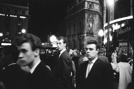 Passers-by on a London street at night c.1955