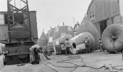 Painting buoys at the Trinity Buoy Wharf, Blackwall, in July, 19