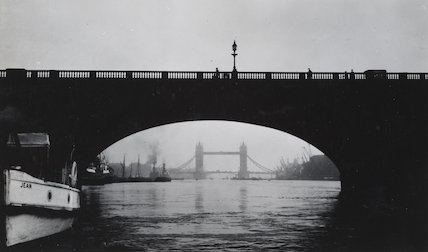 Under one of the arches of London Bridge, into the Upper Pool in March, 1929