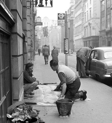 Two men repairing the pavement. c.1955