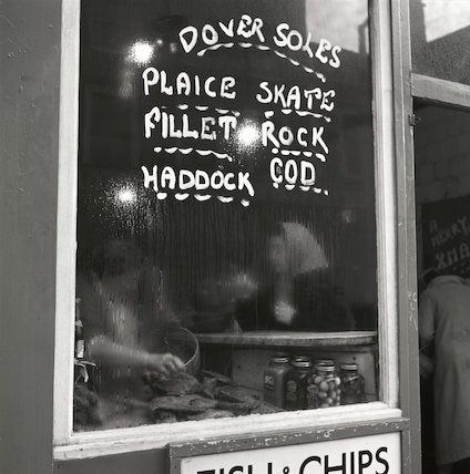 Window of a fish and chip shop. c.1955