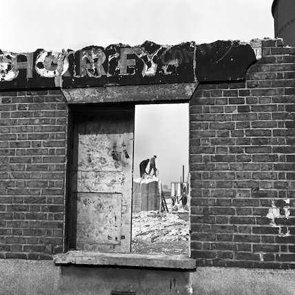 Demolition men viewed through derelict builiding. c.1955