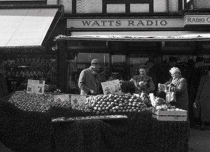 Two women buying cauliflowers. c.1955