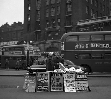A woman newspaper vendor outside Victoria Station. c.1955