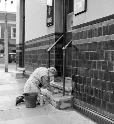 Woman scrubbing step. c.1955