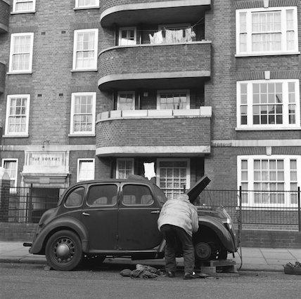 Man repairing a car c.1955