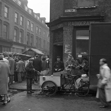 Busy street market near Brick Lane. c.1955