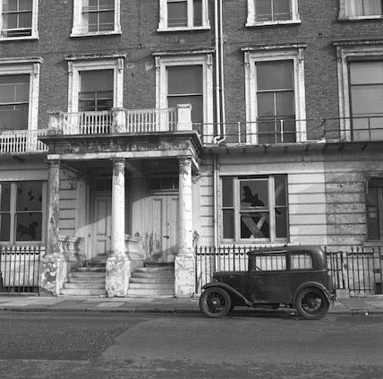 Vintage car parked in street. c.1955