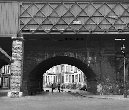 Children playing under a railway bridge. c.1955