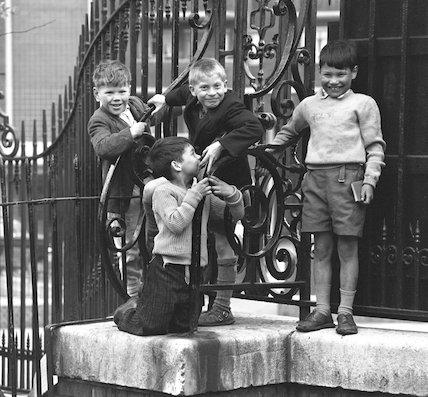 Four boys by railings. c.1955