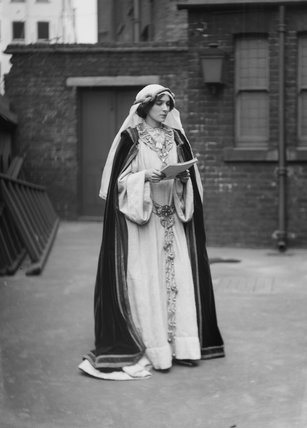 A suffragette in historic costume; 1909
