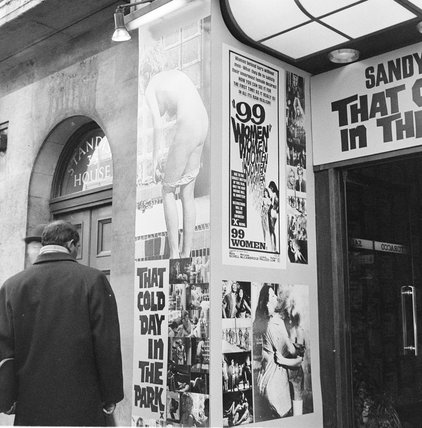 Posters advertising 'That Cold Day in the Park' and '99 Women'.