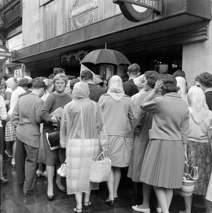 Queues outside Bond Street underground; 1960