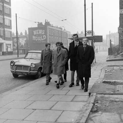 Group of men walking in a London street; 1959