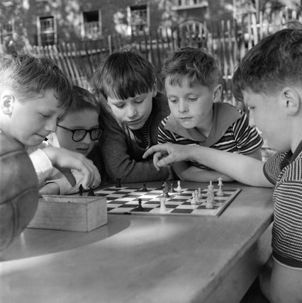 Boys playing chess; c.1965