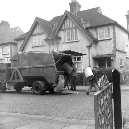 Dustbinmen outside a house in Shepherds Bush, 1959