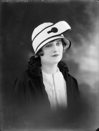 A woman modeling a hat: 1924