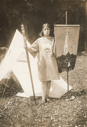 Woman in surcoat with Kibbo Kift banner c1925