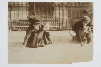 Image of two suffragettes writing on a pavement.1909
