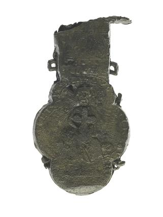 Reverse of pewter ampulla- holy water bottle: 13th century