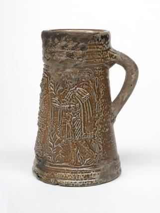 Dark grey stoneware tankard: mid 16th century