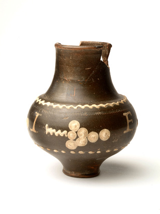 Roman motto beaker of black colour-coated ware