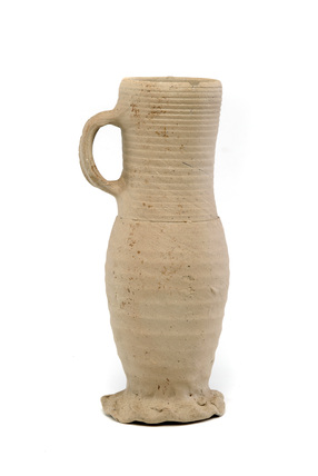 Creamy clay drinking jug: 14th century