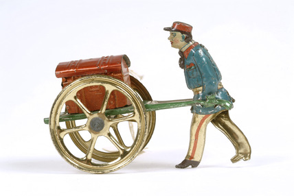 Mechanical penny toy porter and trunk: 20th century