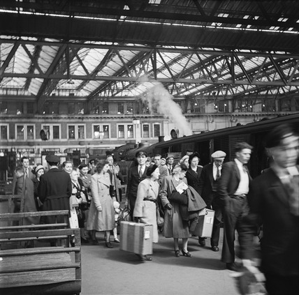 Rail passengers on a platform in Waterloo Station: 1950