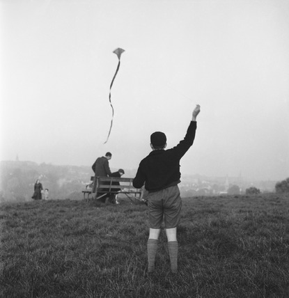 A boy flies a kite on the summit of Parliament Hill, Hampstead Heath: 1950's